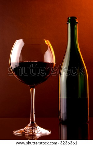 red  sparkling wine, glass and green bottle