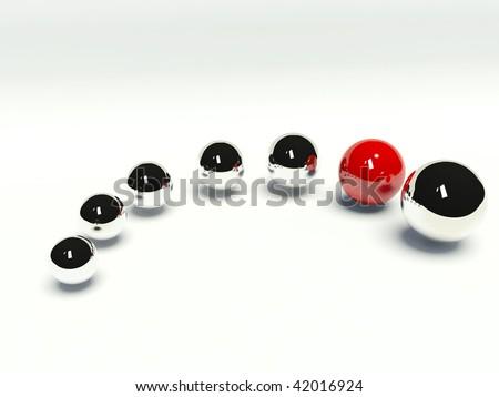 Red sphere among chrome spheres