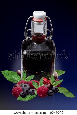Red spirit in old bottle with red fruits - montage