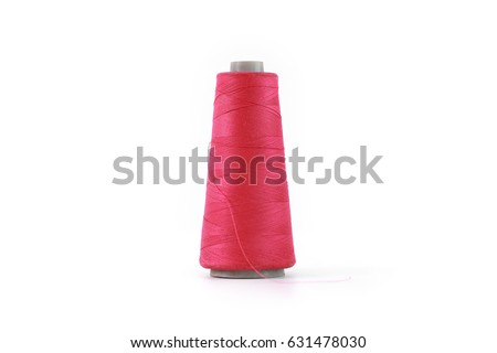 Red spool of thread isolated on white background