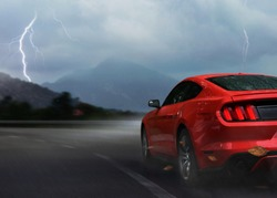 Red sport car drive on mountain highway in storm night