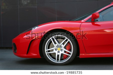 red sport car in the town wheel