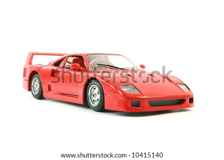 red sports car miniature isolated on white background