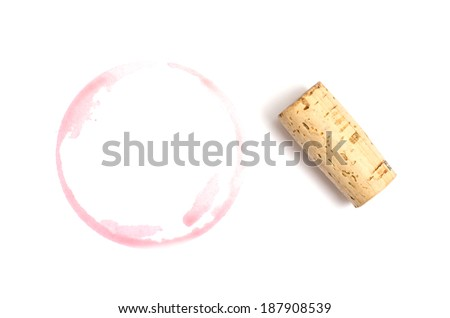 Red spot of wine with cork on white background