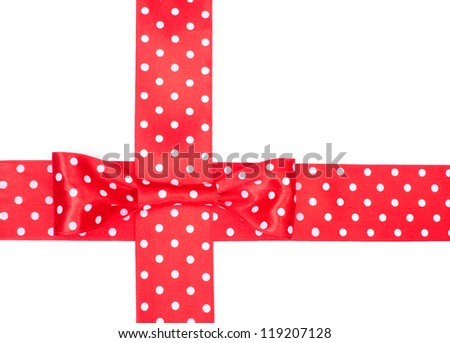 Red spotted ribbon with bow on white background