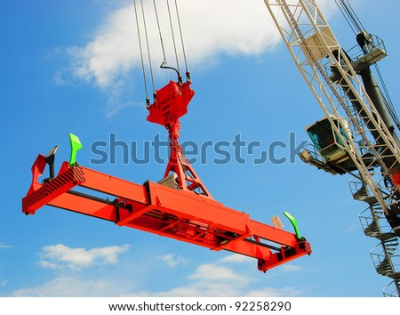 Red spreader and crane on the blue sky background #92258290