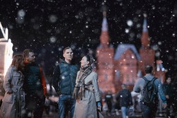red square evening winter, a group of friends for a walk new year christmas moscow russia