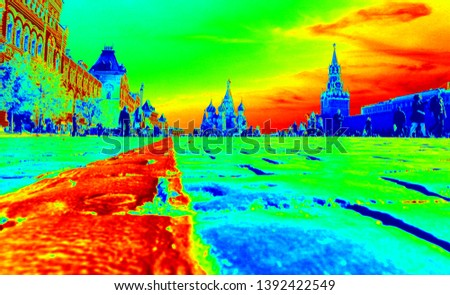 Red Square Moscow Russia. Camera on the ground on the straight line used for parades. Gum on the left. Saint Basil Cathedral in the background. Kremlin walls and tower on the left. Clear sky. Tiles #1392422549