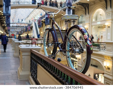 Red Square, Moscow, Russia - February 21, 2016: Decorative retro-styled Electra Cruiser bicycle in GUM department store, shallow depth of field