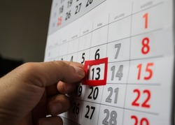 Red square reminder on calendar on friday 13th unluck bad luck superstition