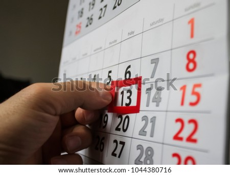 Red square reminder on calendar on friday 13th|unluck|bad luck|superstition Stockfoto ©