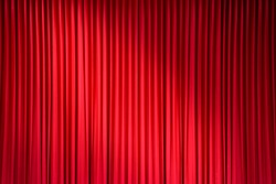 red stage curtain with light spots