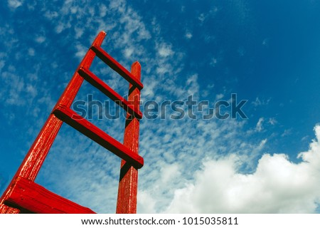 Red Staircase Rests Against Blue Sky. Development Motivation Busines Career Growth Concept #1015035811
