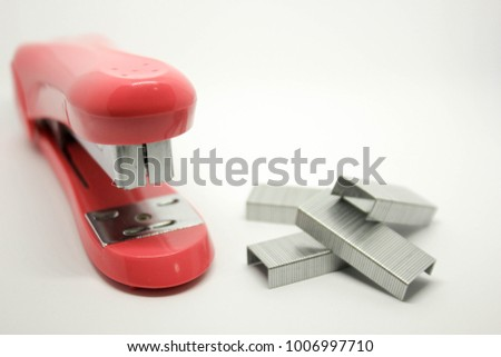 Red stapler and staples the office and stationary tools