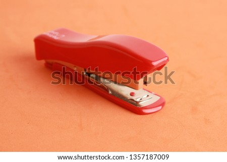red stapler in color background