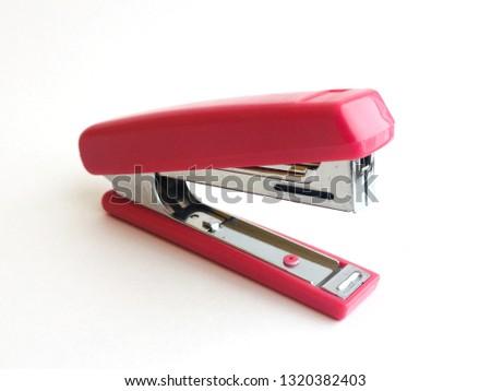 Red stapler, or stapler on a white background
