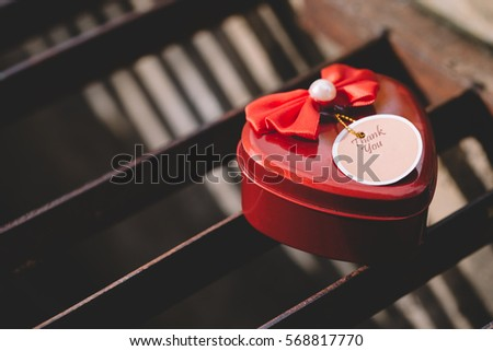 Red steel heart box on iron grille with shade selective focus, valentines day or love concept and best for wedding invitation processed vintage style