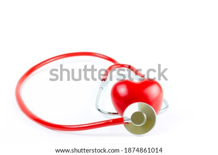 Photo of  Red Stethoscope  and shape Heart Isolated On White Background.Blood pressure control