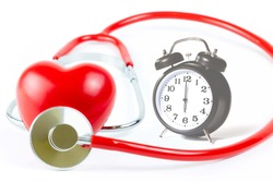 Red Stethoscope,shape Heart and clock Isolated On White Background.Blood pressure control-Health care concept