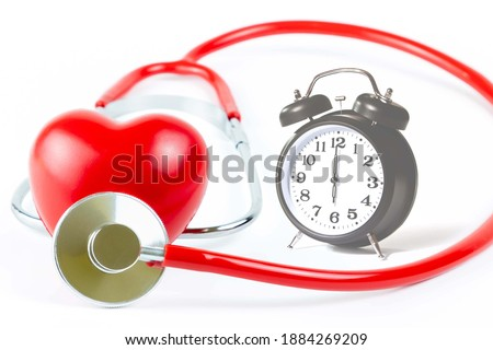 Photo of  Red Stethoscope,shape Heart and clock Isolated On White Background.Blood pressure control-Health care concept