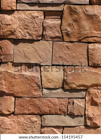 Red stone brick wall in the desert midday sun, Phoenix, Arizona for use as background