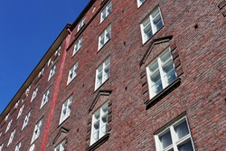 Red stone bricks white windows building house in streets of Helsinki european city. Good architecture elements composition