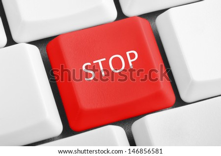 Red stop button on the white keyboard.