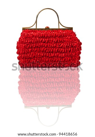 Red straw bag on white with reflexion. - stock photo