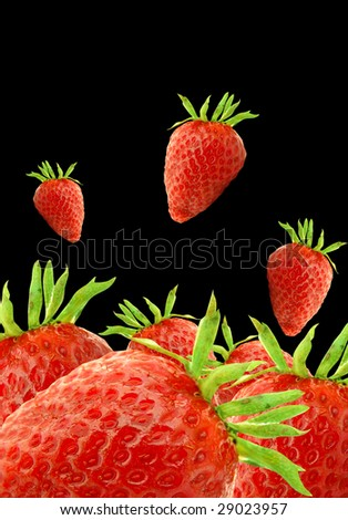 red strawberries isolated on the black background