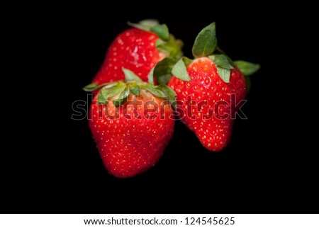 Red Strawberries on a Black Background