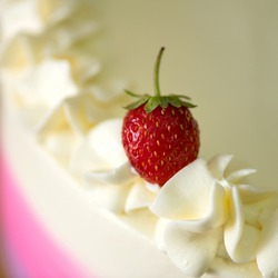Red strawberries on the cream of the cake. Close-up of the strawberries on the cake. Sweetness for a loved one. Sweet passion. Red passion. Passionate impulse. Dessert for Valentines Day. Cake for