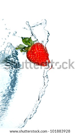 Red strawberry and flowing water on white background. Isolated with clipping path
