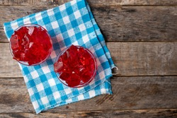 Red strawberry jelly on wooden background