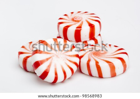 Red striped peppermints on a white background.
