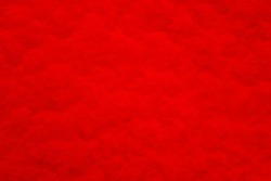 Red structured background with vignetting, darkening at the edges of the photo