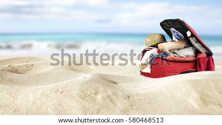 red suitcase in yellow sand and sea background  #580468513