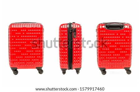 Red suitcase on wheels isolated on white background. Red suitcases for travel