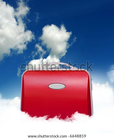 Red suitcase siting in the middle of a cloud in a surreal fashion with sky background