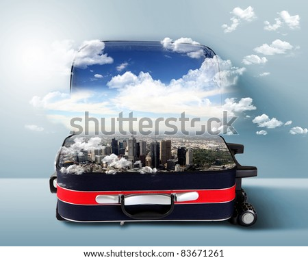 Red suitcase with city on the horizon and blue sky inside