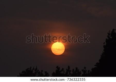 Red sun weather phenomenon due to sahara dust from hurricane ophelia #736322335