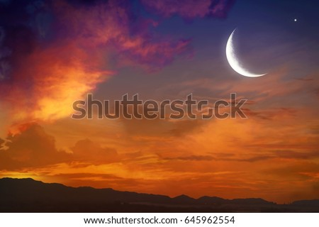 Red sunset and moon  .  Against the background of clouds . beautiful sky . NASA . Yellow and pink clouds . Sunset and new moon  .  Prayer time  .   Generous Ramadan