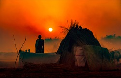 Red sunset man silhouette in Africa. Sunset man silhouette. Africa sunset man silhouette