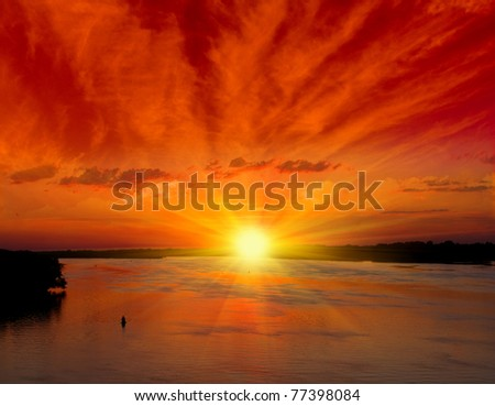 Red sunset over river