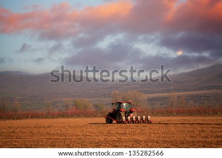 Red sunset over the cultivated farmlands- HDR agricultural background