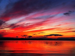 red sunset sky over the lake, dramatic lighting