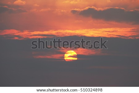 Red sunset with stormy cloud, colorful sky and clouds on sunset.