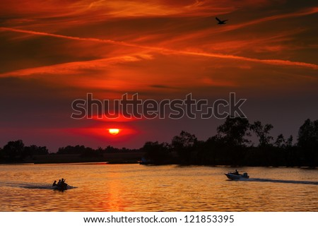 red sunset with water
