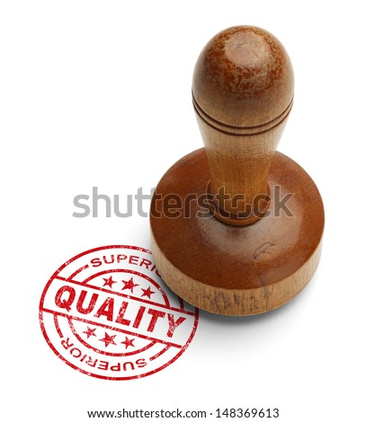 Red superior quality stamp with wooden stamper isolated on white background.