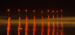 Red Surreal Lights-These red surreal lights were captured in a pilgrimage called Gangasagar in India during winters.