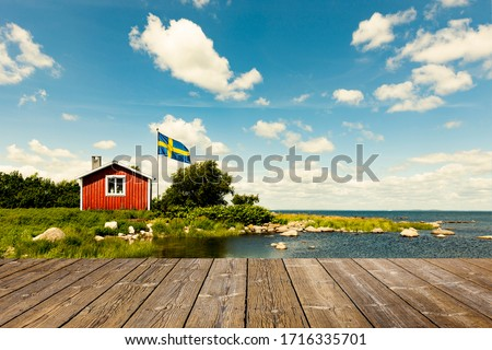 Red Swedish house with wooden terrace Foto stock ©